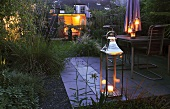 A garden lit by lanterns