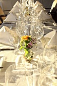 A festively laid table with empty wine glasses