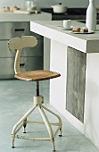 An island kitchen counter with an old bar stool
