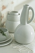 A white carafe and bowls