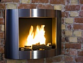 Stainless steel frame around a fireplace with a fire