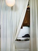 Opened curtain with a view of a wardrobe