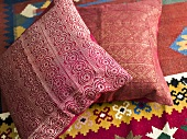 Red pillows with shiny fabric covers