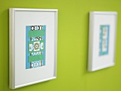 Framed paper craft on a green wall