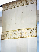 A curtain with gold embossing