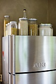 Storage jars on an stainless steel fridge