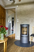 Wood burning stove with bottom plate and open door