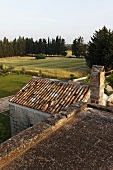 View across the roof of old house onto the Italian countryside