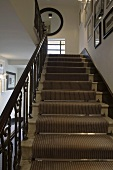 Stairway with a striped stair runner