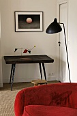 Wall table with a mobile and black floor lamp