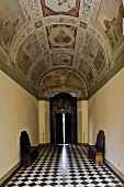 Impressive frescos painted on a barrel vault ceiling and floor with a checkerboard pattern