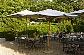 'Sunny mood' on a restaurant terrace with patio furniture and sun umbrellas