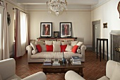 Elegant living room in a country home with light gray upholstered furniture on terracotta flooring