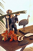 Wooden animals and tropical fruit on a wooden bench
