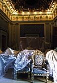 Restoring a room in a castle -- seating under protective covers in a hall