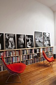 Red Bauhaus chairs in front of half-high bookshelves in a living room