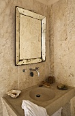 Tiled corner of a bathroom -- stone vanity with framed vintage style mirror