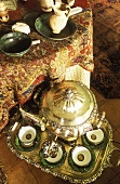 A tea break with a samovar in room done in North African style