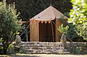 Tent on a garden terrace with natural stone steps