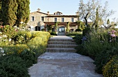 Private path with stairs through the front garden of a Mediterranean villa
