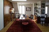 Open 50's style living room with wood paneled wall