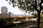 Celebration on a roof terrace - chairs and tables on a floor wet with rain