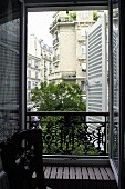 View through an open window of the apartment house across the way