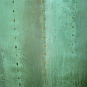 Riveted copper sheeting with copper rust