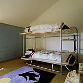 A lightweight bunk bed under a slopping roof