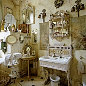 A Rococo-style bathroom - white wash basin with a cast iron frame and playful accessories