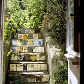 Steps decorated with various tiles in a rear courtyard