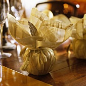 Christmas decorations wrapped in golden fabric
