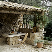 Covered patio area in Mediterranean style out of natural stone