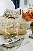 A table laid with silver Christmas decoration and table decorations