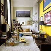 A high ceilinged, 70s-style living room with a flokati rug and a brown armchair in front of a yellow wall