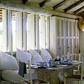 Breakfast in a tropical holiday home with a comfortable bench with white cushions