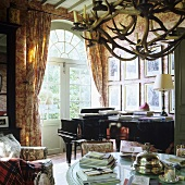 A piano in front of arched terrace doors in a French country house