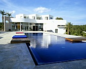 A blue sky above a Mediterranean luxury villa with a pool
