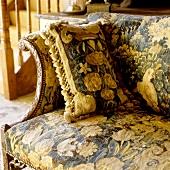 A sofa with a matching cushion