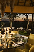 A set table with candlelight on a terrace of a South African home