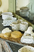 French cheese on a stone shelf with antique cheese dishes