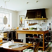A new country house-style kitchen with a black and white tiled floor