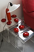 Three acrylic nesting tables decorated with red glass stones