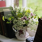 A bunch of garden flowers in a jug
