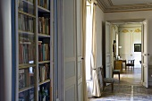 An anteroom with a library cupboard and view into a neighbouring living room