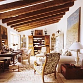 A wood beam ceiling with strong dimensions in a Mediterranean living room