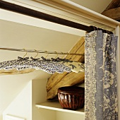 Fabric-covered hangers in a wardrobe
