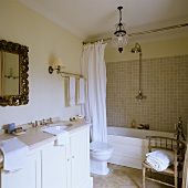 A bathroom in a country house with a marble-topped washstand an antique accessories