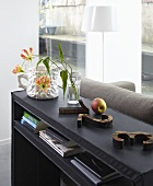 A view of a black shelf in a living room