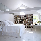 An attic bedroom with a bookshelf and a study corner in a gable
